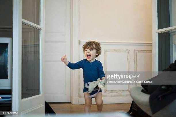 toddler boy playing and laughing - eccitazione foto e immagini stock