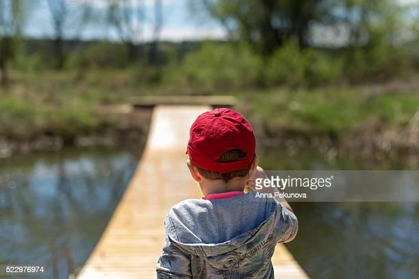 toddler boy playing at pontoon bridge - pontoon bridge stock pictures, royalty-free photos & images