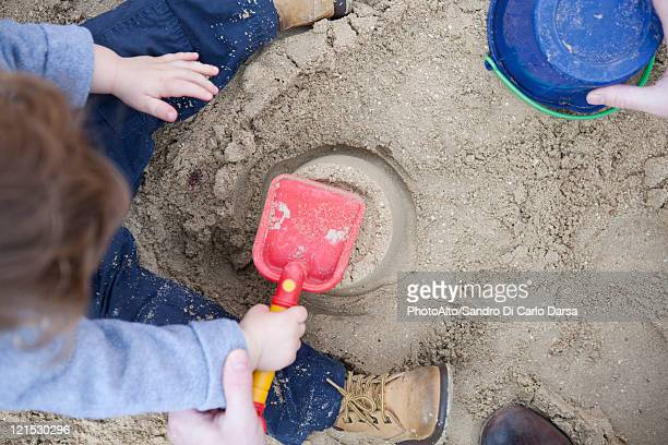 Toddler boy playing in sand