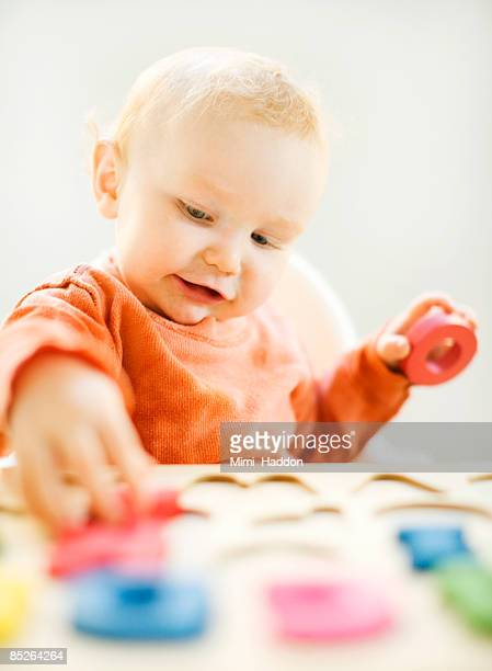 toddler boy playing with letters
