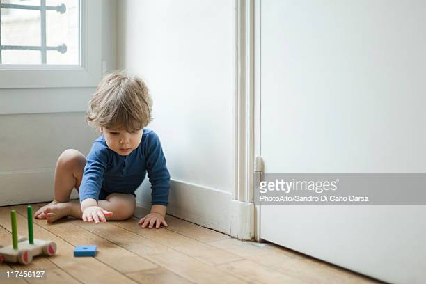 Toddler boy playing with toy