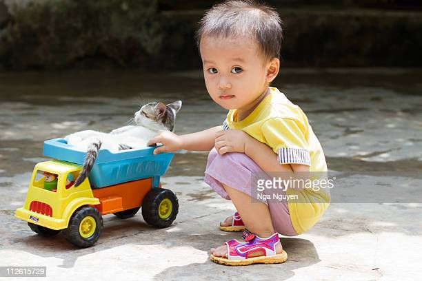 Toddler boy playing with toy truck