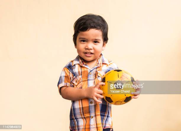 toddler boy portrait with ball - baby boys stock pictures, royalty-free photos & images
