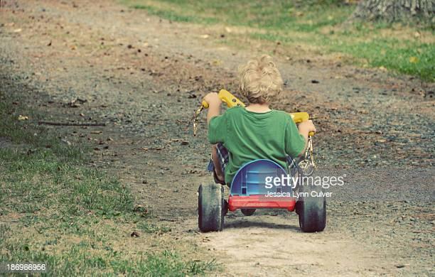 Toddler Boy Riding Big Wheels