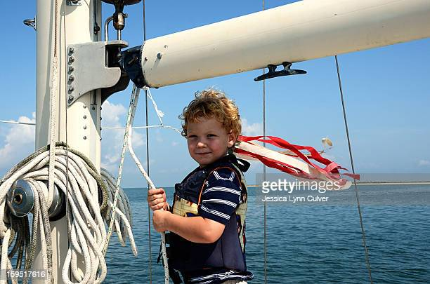 toddler boy sailing - sail boom stock pictures, royalty-free photos & images
