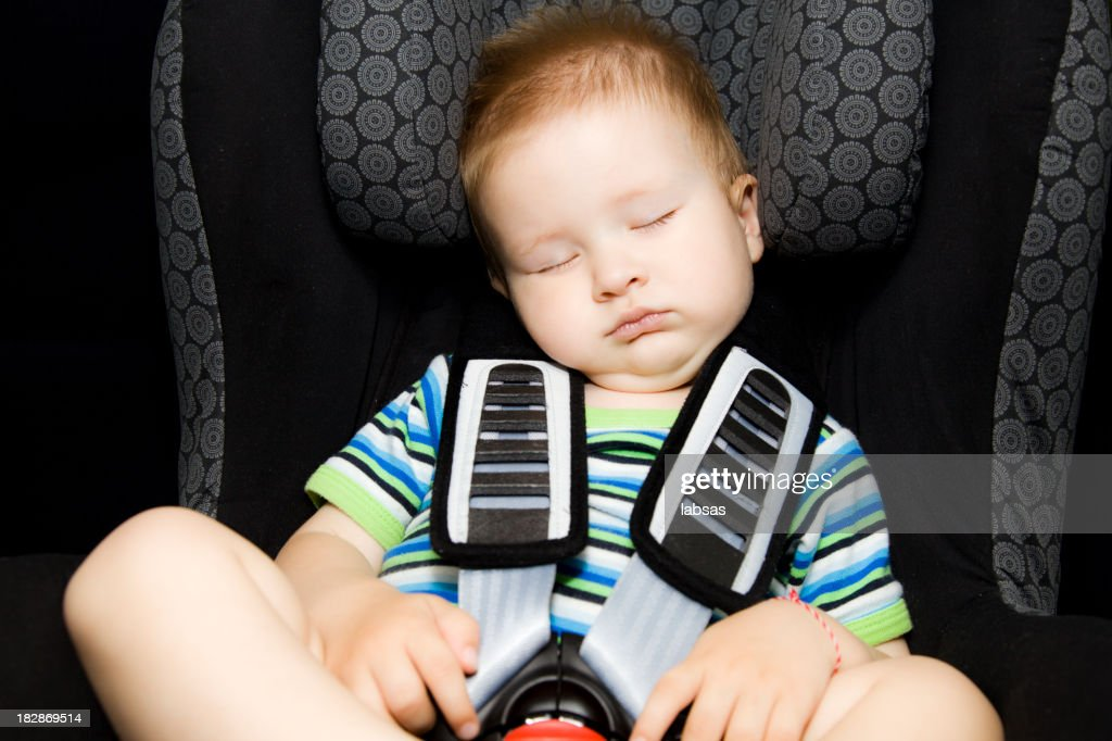 Toddler Boy Sleeping Peacefully In His Baby Car Seat Stock Photo