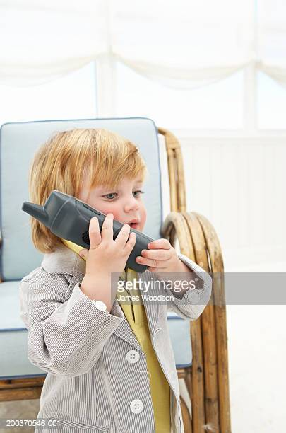 toddler boy (12-15 months) using telephone, side view, close-up - 12 23 months stock pictures, royalty-free photos & images