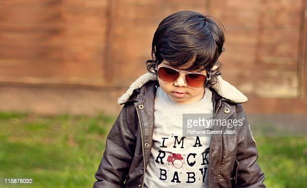 Toddler boy wearing aviator sunglasses