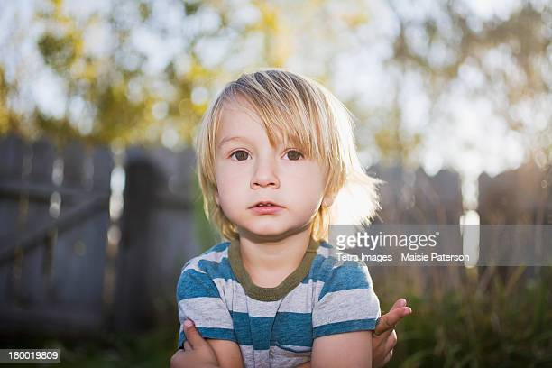 Toddler boy with arms crossed