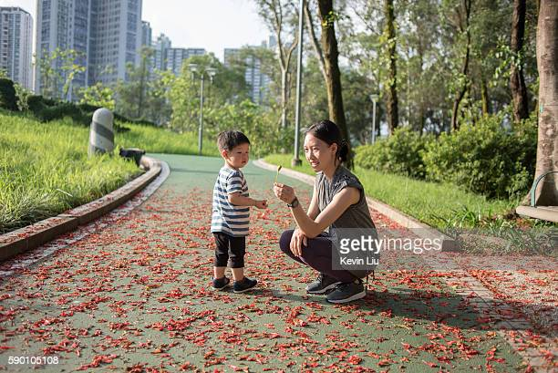 Toddler boy with mum at park