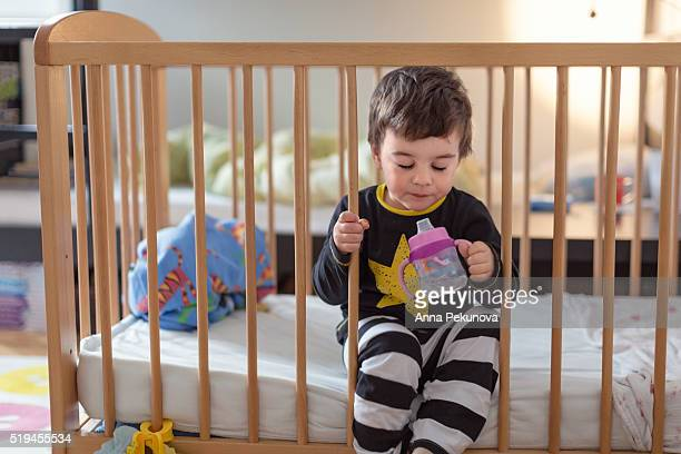 Toddler boygetting out of his bed