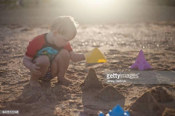 Toddler building sand castles