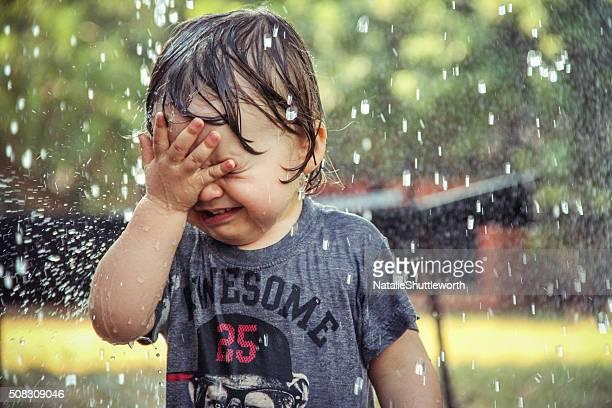Toddler caught in the rain