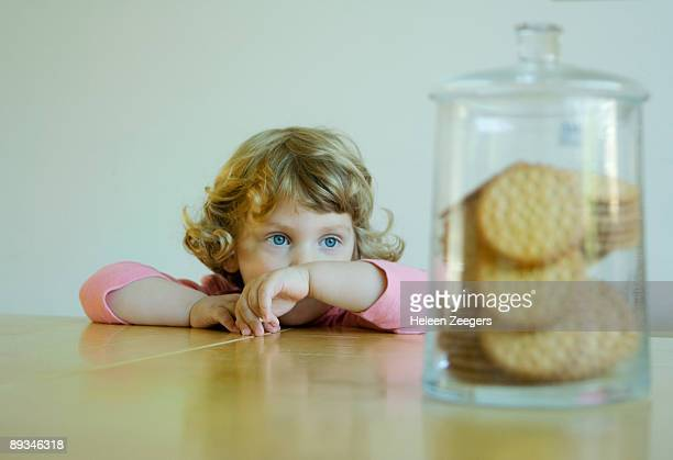toddler child longing for and looking at cookies