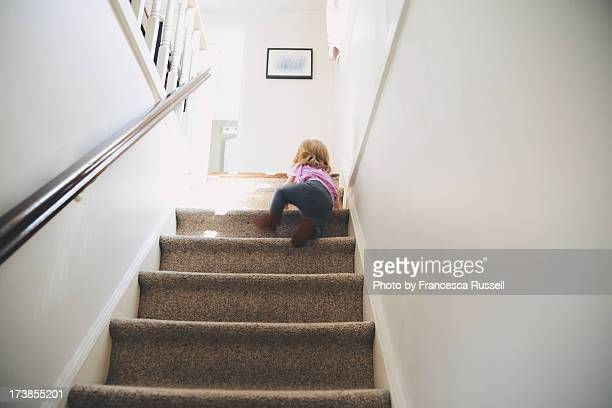 Toddler climbing stairs.