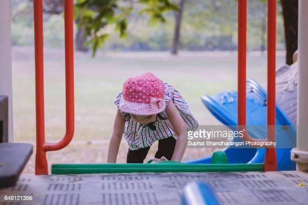 Toddler climbing up the playhouse