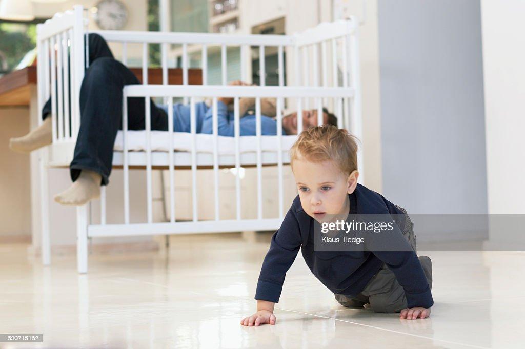 Toddler crawling : Stock Photo