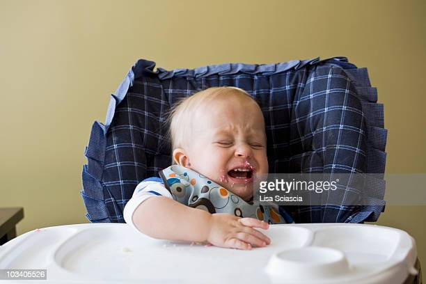 a toddler crying in his high chair - lisa loud stock pictures, royalty-free photos & images