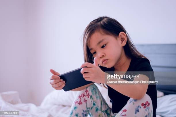 Toddler curious about a video clip on smartphone
