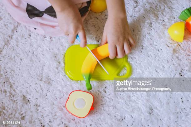 Toddler cutting banana