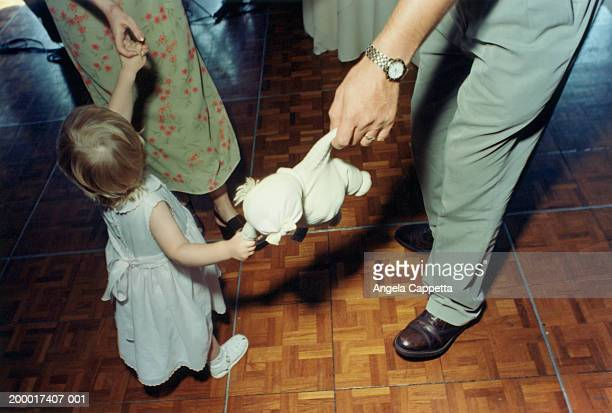 toddler dancing with parents, father holding doll - low section stock pictures, royalty-free photos & images