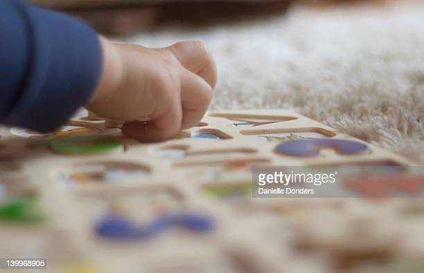 Toddler doing alphabet puzzle