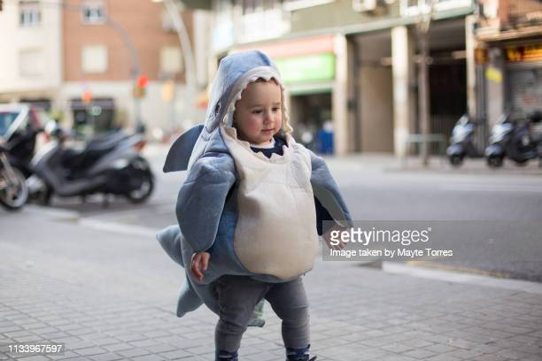 toddler dressed as a shark in the street - fish love stock pictures, royalty-free photos & images