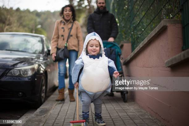 toddler dressed as a shark with grandma and dad - fish love stock pictures, royalty-free photos & images