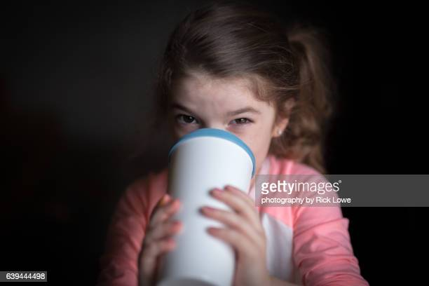 Toddler drinking from cup