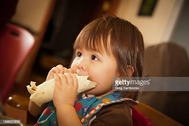 Toddler Eating a Burrito