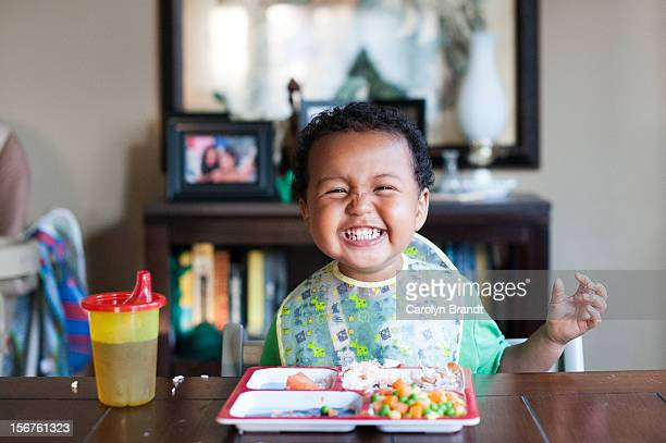Toddler eating healthy lunch