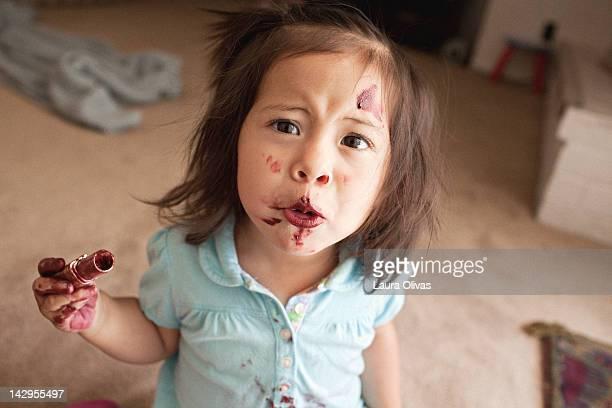 toddler eating lipstick - naughty america foto e immagini stock