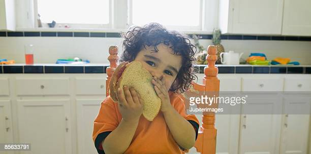 Toddler eating sandwich