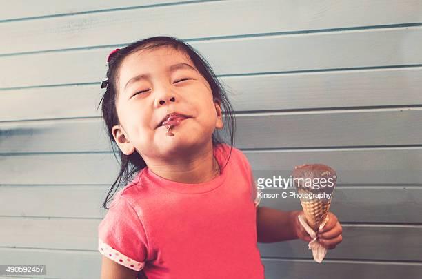 Toddler enjoying her ice-creme