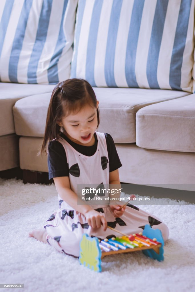 Toddler enjoying her new song : Stock Photo