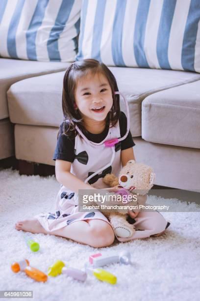 Toddler enjoying her role-playing