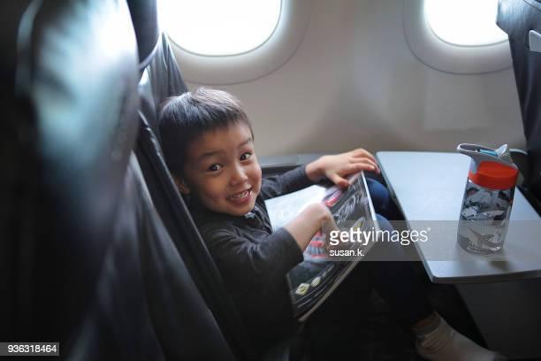 toddler enjoying his flying experience. - treats magazine fotografías e imágenes de stock