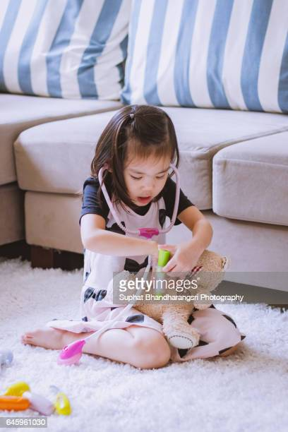 Toddler examining her friend's heart