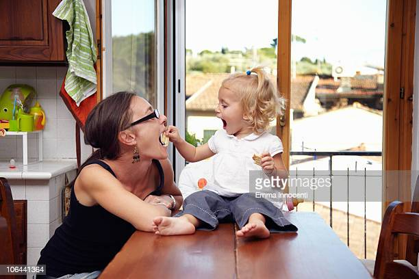 toddler feeding mum - cracker snack stock pictures, royalty-free photos & images