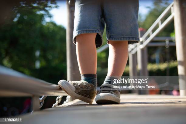 toddler feet in the playground - autism awareness stock pictures, royalty-free photos & images