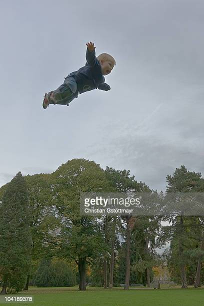 toddler flying like a bird - basel switzerland stock pictures, royalty-free photos & images
