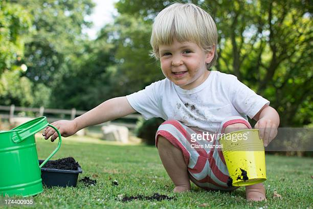 Toddler getting grubby in the garden