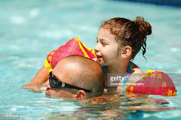 Toddler girl and her uncle in pool