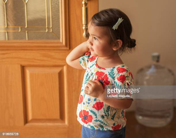 Toddler Girl Answers The Door