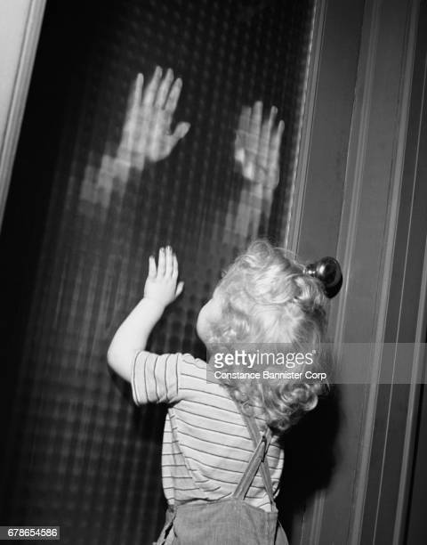 toddler girl at front door - constance bannister stock photos and pictures