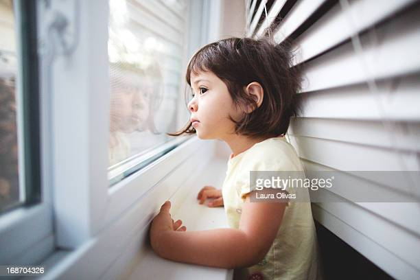 toddler girl by window - waiting stock pictures, royalty-free photos & images