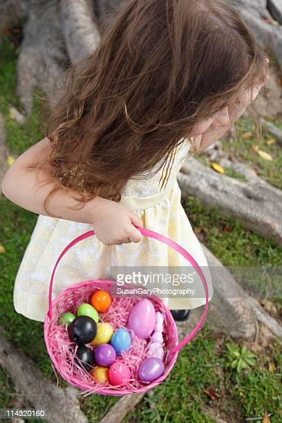 Toddler girl carrying Easter basket