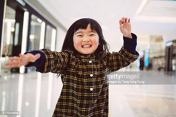 Toddler girl dancing in front of camera joyfully