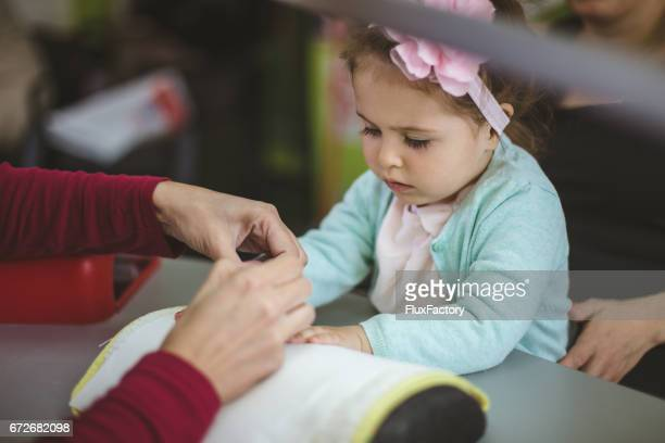 Toddler girl gets her nails done