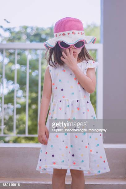 Toddler girl going out undercovered on a hot summer day